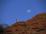 A Hiker Ascending a Ridge, as If Climbing Toward the Moon Photographic Print by John Dunn/Arctic Light