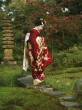 Kimono-Clad Geisha in a Park on a Bridge Above a Stream; She is a Maiko or Apprentice Geisha Photographic Print