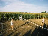 An Umpire Watches a Game on a Tennis Court Carved from a Cornfield Photographie par Joel Sartore