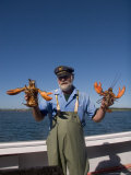 A Man Holds up Two Big Lobsters Photographic Print