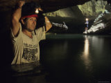 An Archeologist Stands Inside the Cave Photographic Print