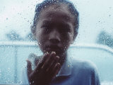 Indonesian Muslim Boy Begs for Money Through a Car Window in Rain Photographic Print
