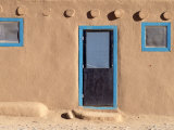 An Adobe House with Turquoise Window and Door Frames Photographic Print by Ira Block
