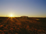 A View of Ayers Rock at Sunset Photographic Print by Jason Edwards