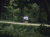 A Couple Walks on the Towpath of the Chesapeake and Ohio Canal Photographic Print by Raymond Gehman
