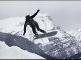 Snowboarder Catches Air, Banff National Park, Alberta, Canada Photographic Print by George F. Mobley