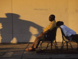 Two Men Relax on City Benches in Downtown New Orleans Photographic Print by Joel Sartore