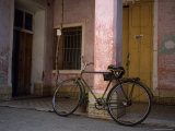 A Chinese Made Flying Pigeon Bike Sits in Front of an Old Building, Trinidad, Cuba Photographic Print by Taylor S. Kennedy