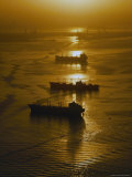 The Sun Setting over Boats in Los Angeles Harbor Photographic Print by Jodi Cobb