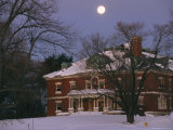 A Full Moon Rises Over a Snow-Covered Mclean Hospital Building Photographic Print by Melissa Farlow