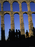 Tourists Stand Next to a Roman Aqueduct in Segovia, Segovia, Spain Photographic Print by Taylor S. Kennedy