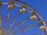 A Ferris Wheel against a Blue Sky Photographic Print by Raul Touzon