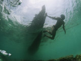 Underwater View of Moken Tribesmen Swimming as He Holds onto a Boat Photographic Print by Nicolas Reynard