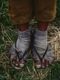 A Sulfur Miner Wears Slippers and Worn Fabric with Holes for Socks Photographic Print