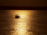 Morning Sun Silhouettes a Workboat Checking a Line of Crabpots Photographic Print by Stephen St. John