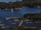 Aerial View of a Yacht Sailing in the Aland Islands, Finland Lmina fotogrfica por Cotton Coulson