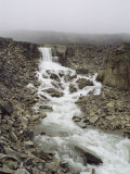 The Okpilak River Flowing Through a Rocky Landscape, Alaska Photographic Print by George F. Mobley