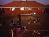 Residents of the Aboriginal Settlement of Balgo in the Great Sandy Desert Pass the Evening Photographic Print by Sam Abell