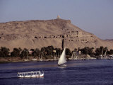 A Scenic View of Boats Gliding Along the Nile Near the Aswan Harbor Photographic Print by Stephen St. John