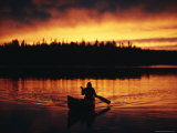 Silhouetted Canoeist on the Water at Sunset Photographic Print by Bill Curtsinger