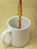 A Cup of Energy Filled Coffee is Poured into a Mug Photographic Print by Taylor S. Kennedy