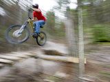 Mountain Biker Riding Stunts in Whitefish, Montana, USA Photographic Print by Chuck Haney