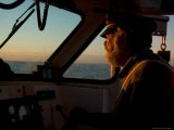 A Captain Navigates His Fishing Boat to His Traps at Sunrise Photographic Print by Taylor S. Kennedy