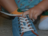 A Toddler Tries to Tie a Shoe Photographic Print by Stacy Gold