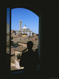 A Man Silhouetted in a Window Overlooking the Cathedral in Siena Photographic Print by Taylor S. Kennedy