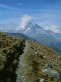 View Down a Trail Towards the Cloud-Shrouded Matterhorn Photographic Print by Taylor S. Kennedy