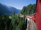 The Glacier Express Crosses a Bridge in Switzerland Photographic Print by Taylor S. Kennedy