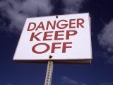 A Bold Sign Warns of Danger, in This Case Climbing Breakwater Rocks Photographic Print by Stephen St. John