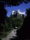 A Man Walks Toward the Salzburg Castle, Salzburg, Austria Photographic Print by Taylor S. Kennedy
