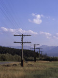 A Powerline Runs Along a Roadway, Northern Colorado Photographic Print by Taylor S. Kennedy