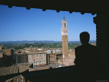 A Silhouetted Man Looking Out at Siena's Campanile Photographic Print by Taylor S. Kennedy