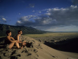 A Couple Enjoys Sunset Atop a Sand Dune, Great Sand Dunes National Park, Colorado Photographic Print by Taylor S. Kennedy