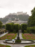Tourists Enjoy a Rainew York Day in the Gardens of the Palace, Salzburg, Austria Photographic Print by Taylor S. Kennedy