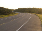 A Road Meanders and Winds Through a Forest on the Island at Sunset, Prince Edward Island, Canada Photographic Print by Taylor S. Kennedy