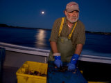 A Lobster Fisherman Goes Out for the Mornings Catch Photographic Print by Taylor S. Kennedy