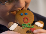 A Gingerbread Man Reacts to Being Eaten by a Young Male Photographic Print by Joel Sartore