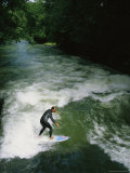 A Man Surfs on the Eisbach River in the English Garden in Munich Photographic Print by Taylor S. Kennedy