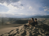 A Couple Watches the Sunset at Great Sand Dunes National Park Photographic Print by Taylor S. Kennedy