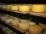 Cheese Ripens on Shelves in a Cave in Switzerland, Pontresina, Switzerland Photographic Print by Taylor S. Kennedy