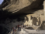 Tourists Admire the Ancient Anasazi Ruins of Mesa Verde, Colorado Photographic Print by Taylor S. Kennedy