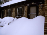 Snow-Buried Front of a Home Shows the Current Depth of a Big Storm Photographic Print by Stephen St. John