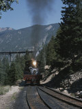 A Steam Engine Comes into the Silver Plume Station in Colorado Photographic Print by Taylor S. Kennedy