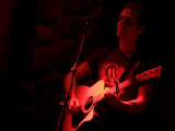 A Singer Performs for the Crowd at a Bar, Whistler, British Columbia Photographic Print by Taylor S. Kennedy