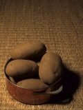 A Group of Baking Potatoes Sit in a Brass Cooking Pot Photographic Print by Taylor S. Kennedy