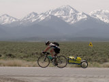 Cross-Country Bicyclist, US Hwy 50, Toiyabe Range, Great Basin, Nevada, USA Photographic Print by Scott T. Smith