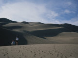 A Couple Look at the Dunes in Great Sand Dunes National Monument Photographic Print by Taylor S. Kennedy